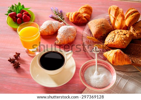 Coffee breakfast with orange juice croissant bread and strawberries - stock photo