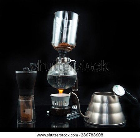 coffee brewing alternative candle burner Kettle thermometer coffee mill  - stock photo
