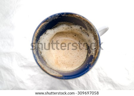 Coffee Bubble in the Coffee Cup on the Brightly White Wrapper - stock photo