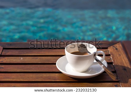 Coffee by the pool in the morning. - stock photo
