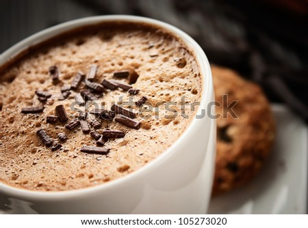 Coffee Cappuccino in white cup with chocolate sprinkles - stock photo