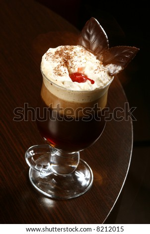 coffee cappuccino with cherry and chocolate on table - stock photo