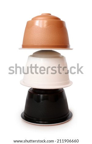 Coffee capsules on white background - stock photo