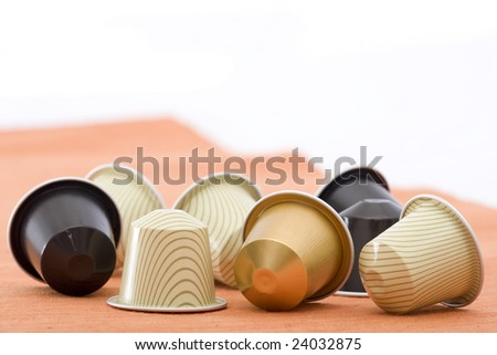 coffee capsules with different colours - stock photo