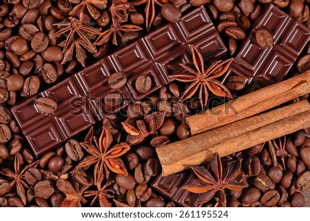 Coffee, chocolate, star anise and cinnamon sticks background  - stock photo