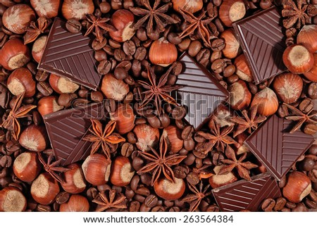 Coffee, chocolate, star anise and hazelnuts background - stock photo