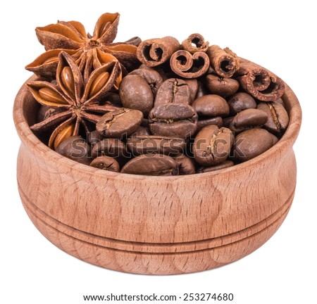 Coffee, cinnamon and star anise in a wooden bowl isolated on white background - stock photo