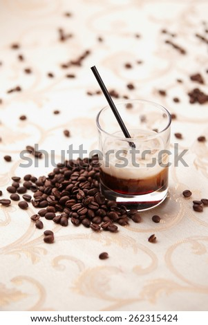 Coffee cocktail on table with coffe grains - stock photo