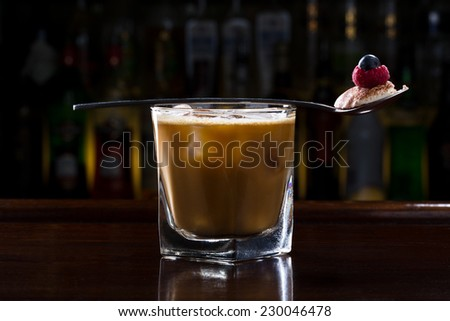 coffee cocktail on the old wooden bar - stock photo