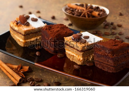 Coffee cream  small cakes and chocolate truffle cakes - stock photo