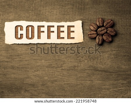 Coffee crop beans with text paper on wood texture background