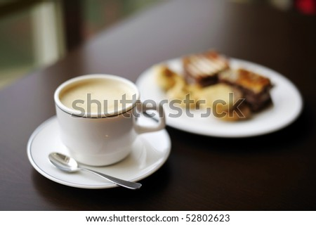Coffee cup and a plate with cookies on a background - stock photo