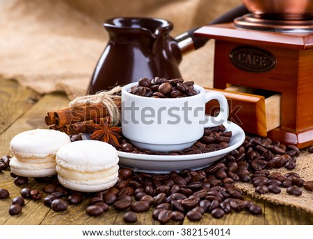 Coffee cup and beans, old coffee grinder and canvas sack