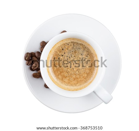 Coffee cup and beans on a white background - stock photo
