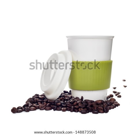 Coffee cup and beans on white background - stock photo