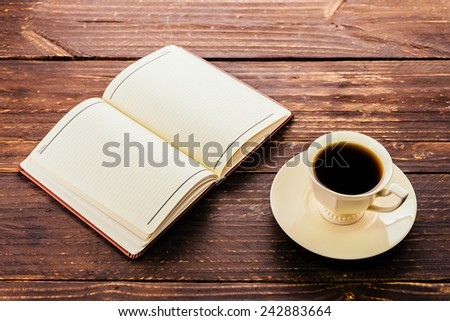 Coffee cup and book on wooden background - Vintage effect style pictures