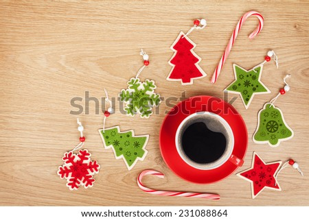 Coffee cup and christmas decor on wooden background with copy space - stock photo