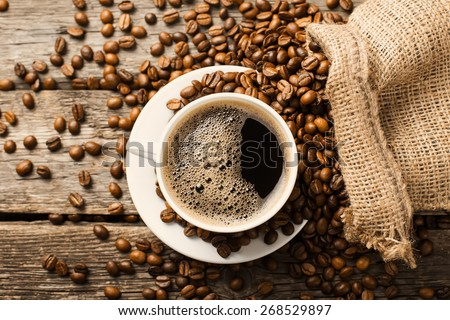 https://thumb1.shutterstock.com/display_pic_with_logo/1159799/268529897/stock-photo-coffee-cup-and-coffee-beans-268529897.jpg