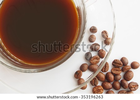 coffee cup and coffee beans on white background