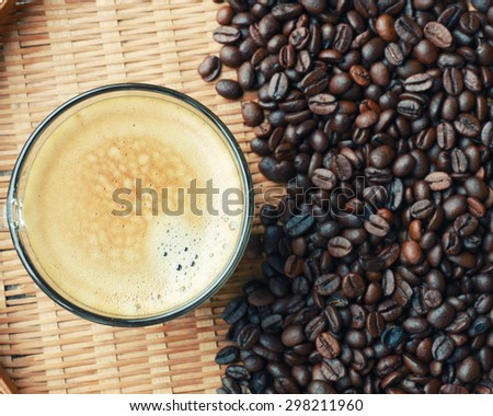coffee cup and coffee beans .Vintage Style. - stock photo