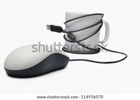 Coffee cup and computer mouse tied together