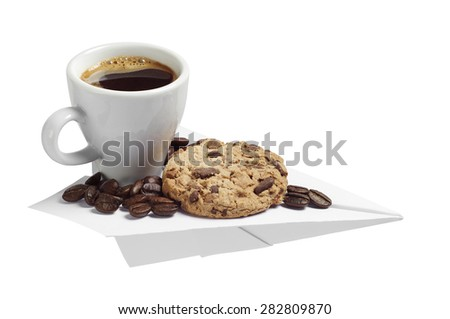 Coffee cup and cookie on a paper airplane isolated on white background. Conceptual photo - stock photo