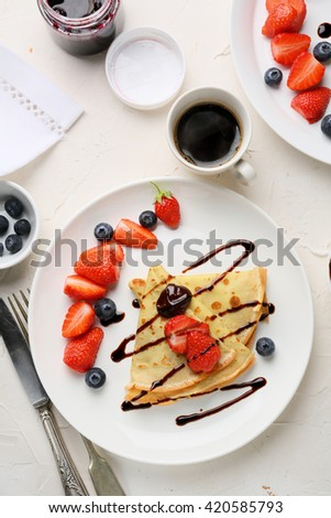 coffee cup and crepes, breakfast food