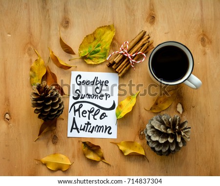 Coffee Cup And Goodbye Summer,hello Autumn Text On A Note On Rustic Wooden  Table