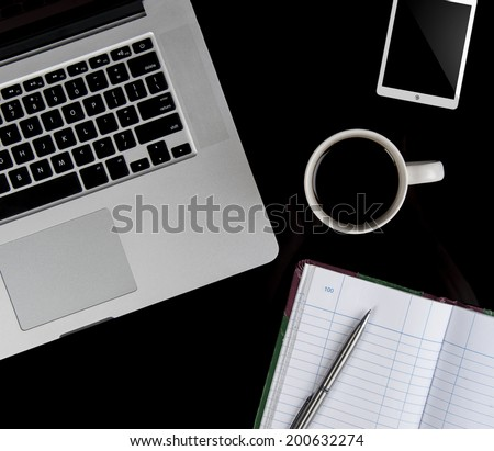 Coffee cup and laptop for business. top view