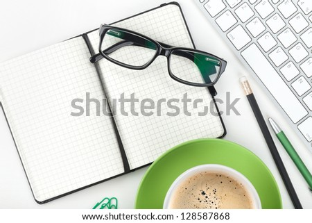 Coffee cup and office supplies. Closeup on white background - stock photo