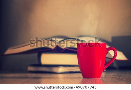 coffee cup and open book