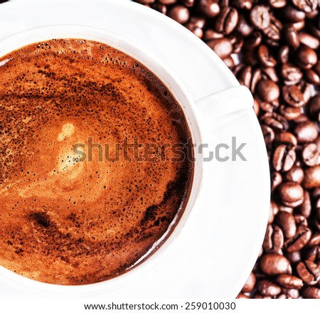 Coffee cup and roasted coffee beans background, close up. Coffee Espresso. Cup Of Coffee macro - stock photo
