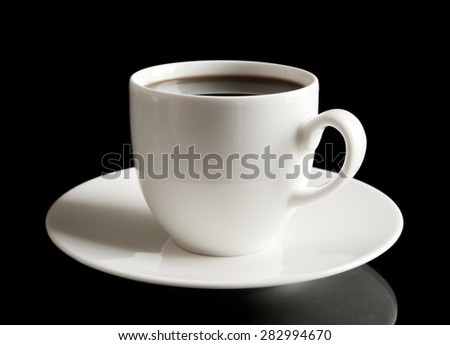 Coffee cup and saucer on black - stock photo