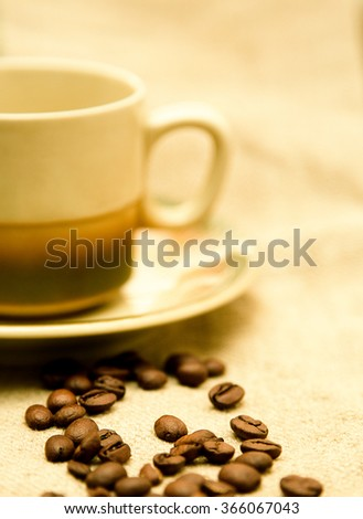 Coffee cup and saucer on canvas background