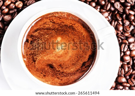 Coffee cup and saucer with roasted coffee beans. Coffee. Coffee Espresso. Cup Of Coffee - stock photo