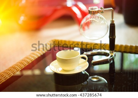 coffee cup and siphon vacuum coffee maker at shop - stock photo