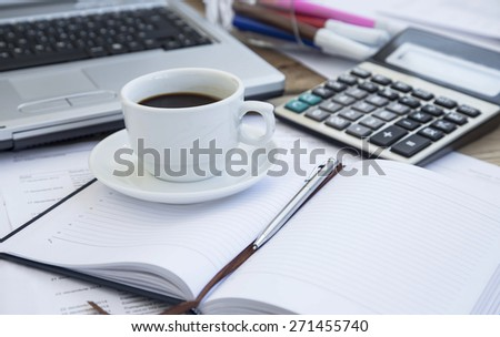 Coffee Cup at Office with Paperwork, Agenda and Pen,Calculator.Coffee Break - stock photo