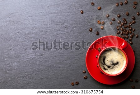 coffee cup background with coffee beans - stock photo