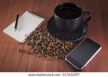 Coffee cup beans with blank notebook