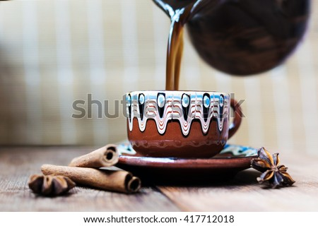 coffee Cup, cinnamon, star anise on wooden background - stock photo