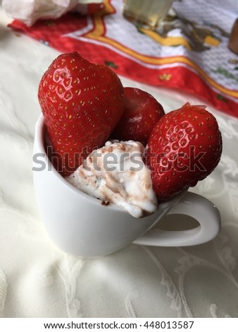 coffee cup filled with ice cream and strawberries on top/ homemade ice cream