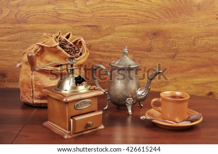 Coffee cup, grinder and coffee pot