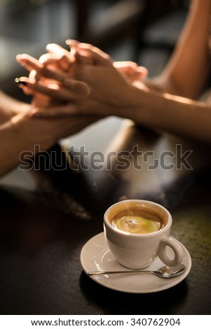 Coffee cup. Hands on the background - stock photo