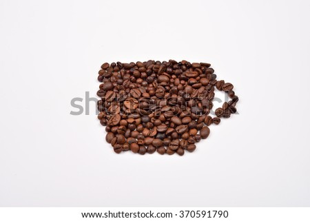 Coffee cup image made up of coffee beans on a white background - stock photo