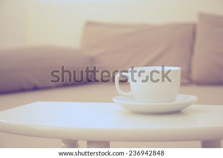 coffee cup in bed room vintage warm color tone - stock photo