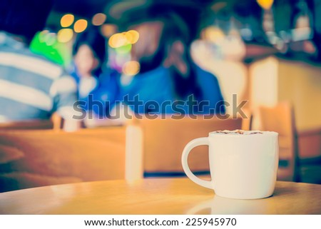 Coffee cup in coffee shop process vintage style picture - stock photo