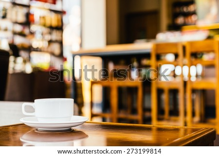 Coffee cup in coffee shop - vintage effect - stock photo