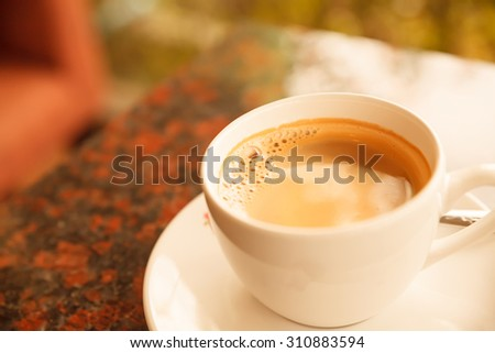 Coffee cup in coffee shop Vintage style. - stock photo