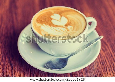 Coffee cup in coffee shop - vintage style effect picture - stock photo