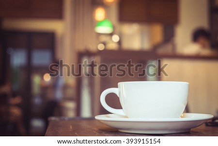coffee cup in coffee shop ,vintage tone  - stock photo